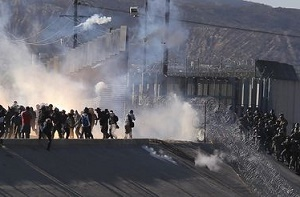 US border agents fire tear gas as some migrants protesting slow asylum process try to breach fence