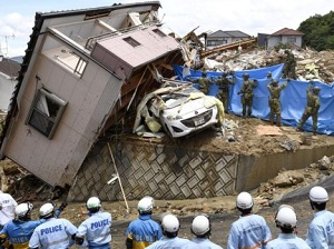 Japan floods: At least 100 dead after record rainfall