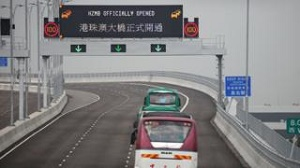 Hong Kong-Zhuhai bridge: World's longest sea crossing opens to quiet start