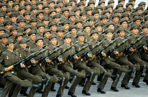 north korean women army. N Korea vows military