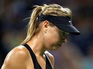 Injured Sharapova withdraws from French Open
