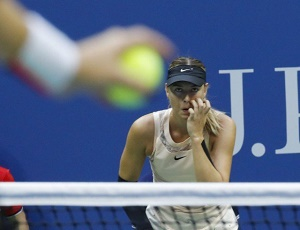 Sharapova battles on to enter third round
