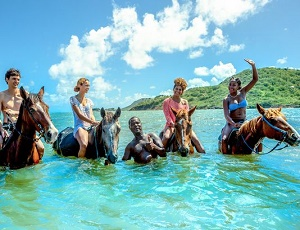Caribbean horseback rides take you off the beach and into the wa