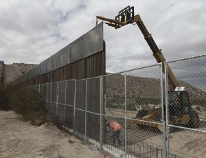 Spending bill excludes border wall, but Trump declares victory anyway